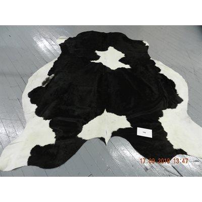 Tapis peau de vache blanc et noir