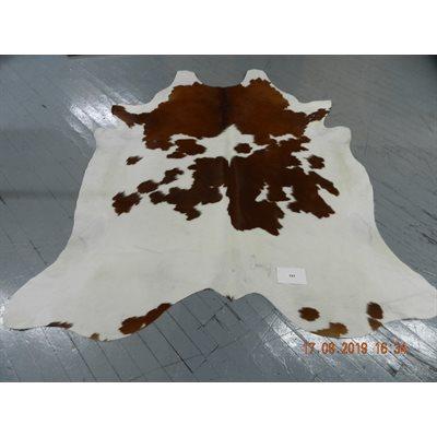 Tapis peau de vache brun et blanc
